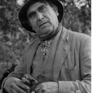 311 - Portrait of an older man wearing a hat holding hop spray