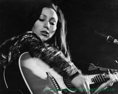 082 - Julie Felix playing guitar