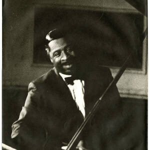 242 - Errol Garner at a Piano