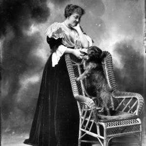 G36-172-01 Portrait of lady standing behind chair.jpg