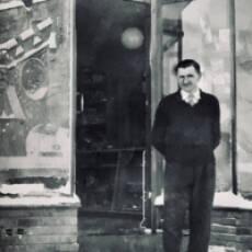 1960s Ted Warren Outside his shop in winter Houghton Regis