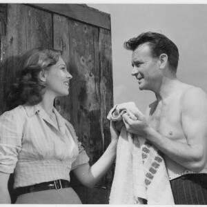 703 - John Mills & Eva Bergh in a scene from The Long Memory