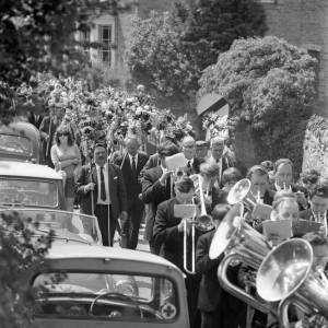 A brass band parading through Fownhope, Heart of Oak walk, 1969.