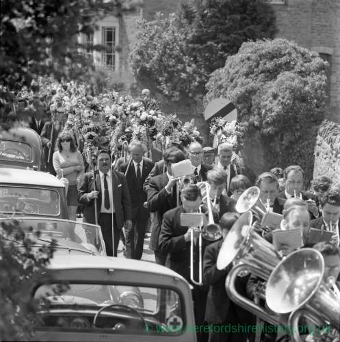 A brass band parading through Fownhope, Heart of Oak walk, 1969.