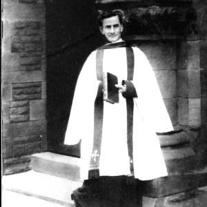 G36-127-10 Portrait of priest in front of church door.jpg