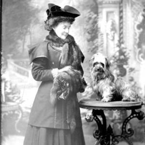G36-161-09 [Mrs Bowerman] and  dog as G36-161-08: lady in dark costume with fur tippet & muff.jpg