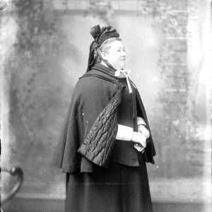 G36-547-08 Lady wearing a cape and bonnet.jpg