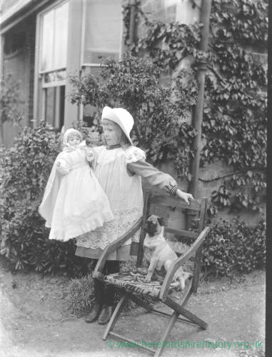 G36-255-07 Young girl with small pug dog sitting beside her.jpg