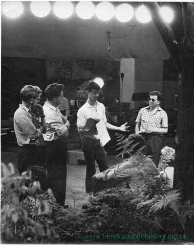 197 - Six men and one woman rehearsing in a studio