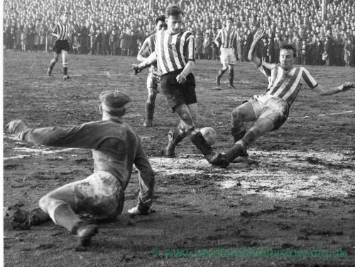 Goalmouth action from a muddy Edgar street, 1950s
