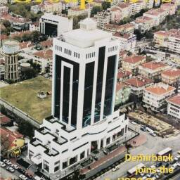 Front page from 'Group News' in November 2001 showing the headquarters of Demirbank TAS in Istanbul, Turkey