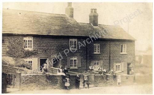 Barnes Hall Farm Cottages with residents standing in front