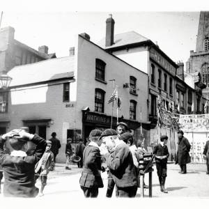 Group of young boys at the May Fair, showing the corner of West Street before rebuilding, Broad Street, Hereford, c.1895