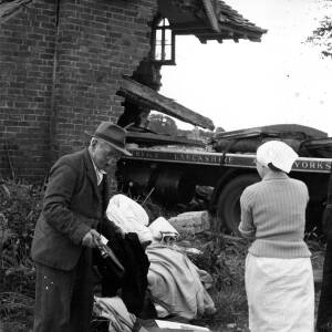 The aftermath of a lorry crashing into a cottage.
