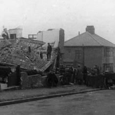 Bomb damage in Erskine Road and Nelson Avenue