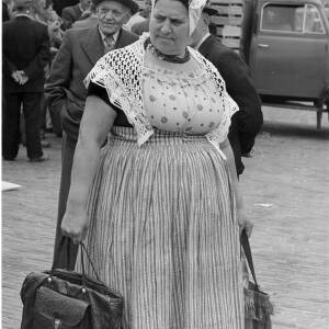 221 - Market scene, lady dressed in costume with older man in suit