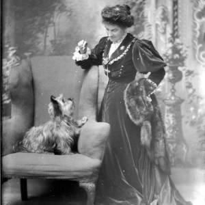 G36-161-08 Lady standing beside chair with dog [Mrs Bowerman].jpg