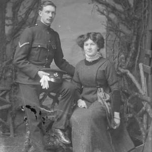 Soldier and lady, both sitting