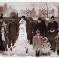 A Victorian Family in Southport posing with a Friendly Snowman