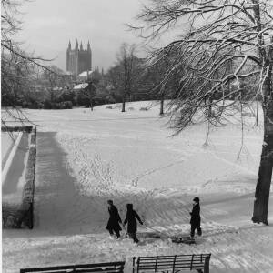 690 - Three youngsters sledging on Castle Green