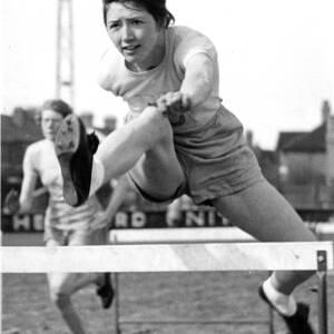 A young woman during a hurdles race.