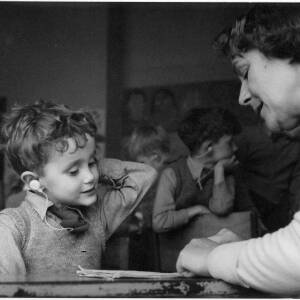 405 - Hearing impaired boy being taught by woman