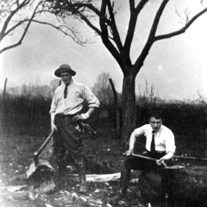 G36-549-15 Two foresters, one with an axe, one with a spade.jpg