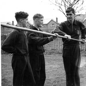 Three athletes training for the javelin.