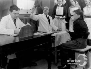 Inspecting a child's x-rays at Nelson Hospital, Merton Park