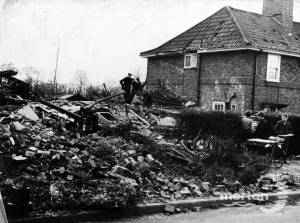 Bomb damage to houses in Martin Way, Morden