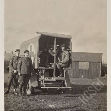 Ambulance showing Captain Buchanan, Staff-Sergeant Cunningham and Sergeant Mill