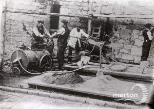 Builders mixing mortar