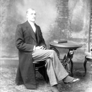 G36-548-05 Man wearing a frock coat and spats.jpg