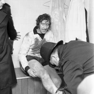 Billy Meadows receiving help from policeman Roy Short after the Hereford United v Newcastle game, Feb 1972.