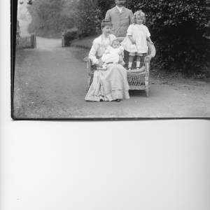 G36-029-01 Family group posed in driveway in garden gateway to lane in background .jpg