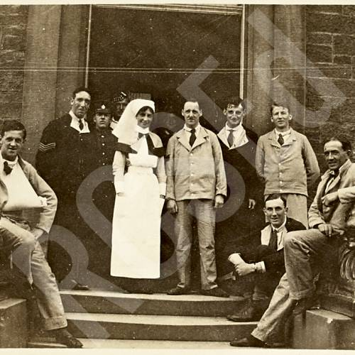 Group of Patients and Nurse on Steps of Hospital Doorway