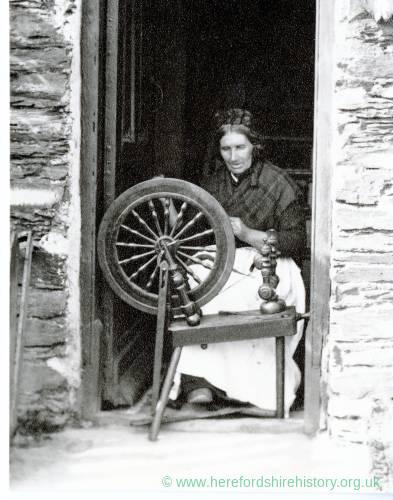 Manx woman using spinning wheel