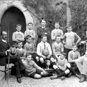 G36-538-16 Blue Coat School football team with 3 masters. Ball inscribed with BCS1910-1911.jpg