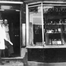 1950 Ted and Mary Warren with James Warren outside their Shop in Bedford road Houghton Regis