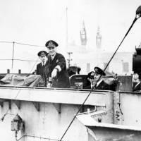 Captain Johnny Walker on the bridge of HMS Starling leaving Gladstone Dock in WW2, 1940s