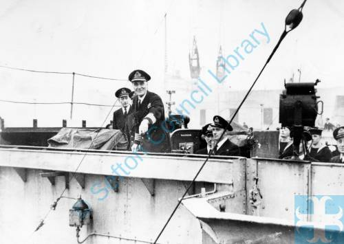 Captain Johnny Walker on the bridge of HMS Starling leaving Gladstone Dock in WW2, 1940s
