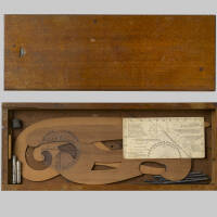 Drawing instruments including curved rulers