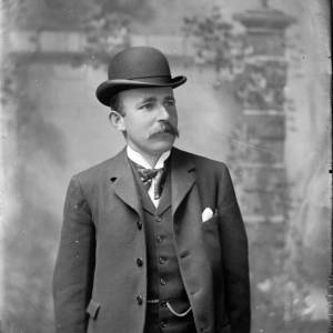 G36-548-09 Man wearing three piece suit and a bowler.jpg