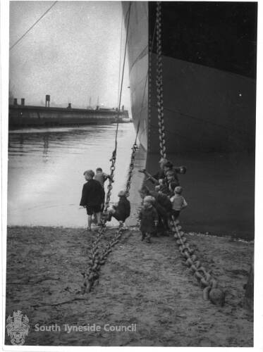 Children Playing Next To A Ship Near The Jetty In South Shields