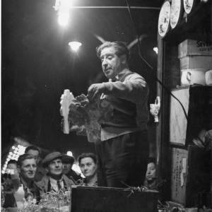 A Hereford May Fair stall holder at night.