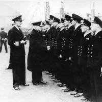 First Sea Lord A.V. Alexander greeting officers of Captain Walker's escort group, Bootle Docks 1944