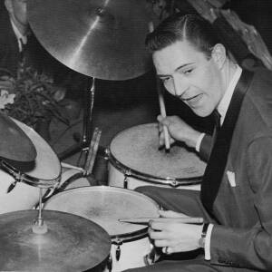 333 - Jack Parnell wearing evening dress and playing drums