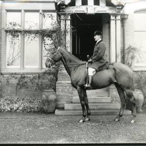 G36-028-06 Captain R. L.Heygate in front of house.jpg