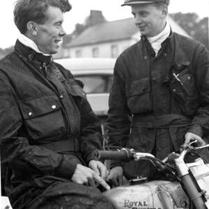 Two men with a Royal Enfield motorcycle.