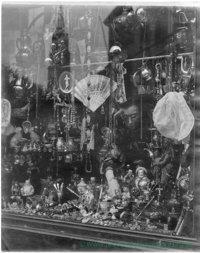 238 - Looking into shop window in Belgium filled with curios